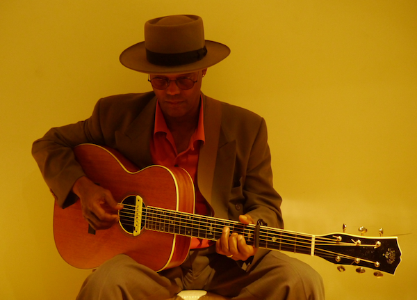 Eric Bibb and a Larson Bros guitar
