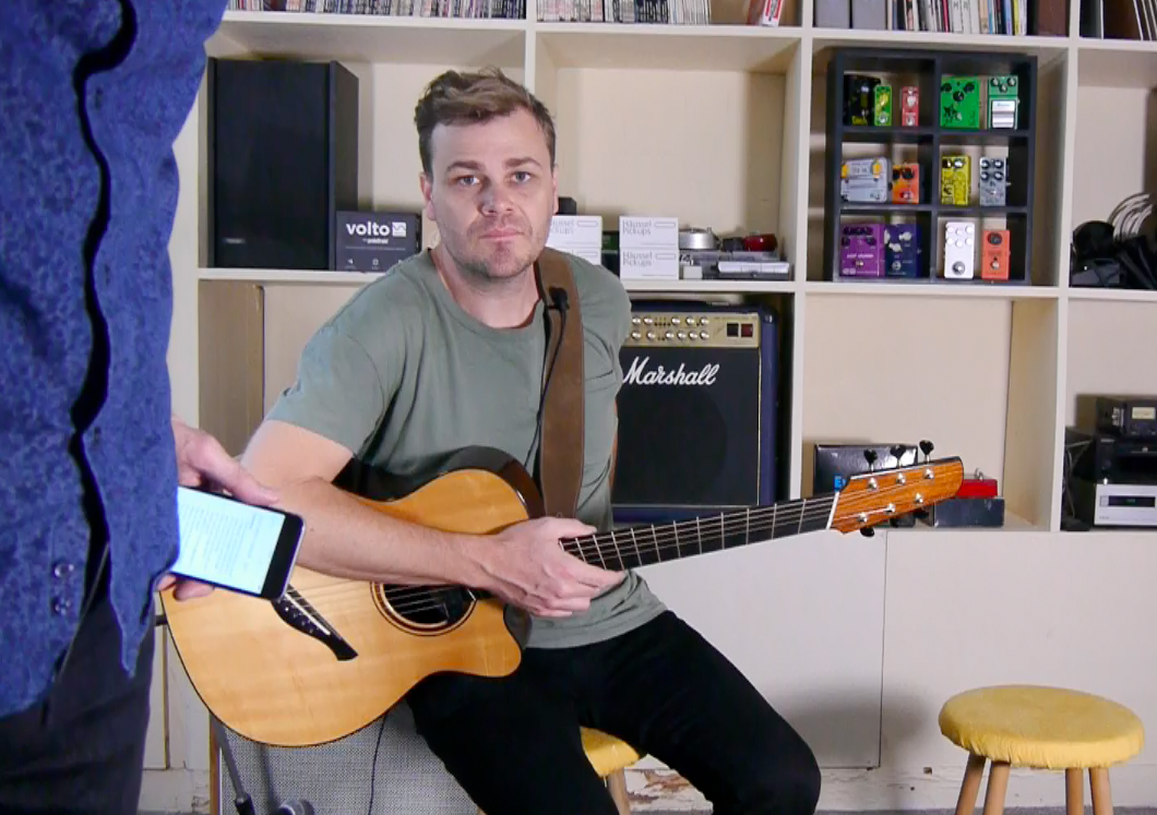 Acoustic guitar in hand interview with Adam Miller